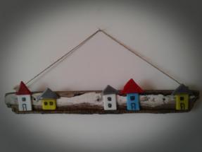 Huse i bullseye glas på drivtømmer